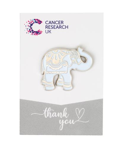 Silver elephant pin badge on white and grey backing card